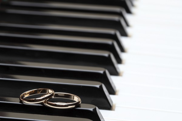 Piano and Wedding Rings.